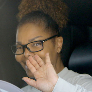 ALL SMILES AS JANET JACKSON STEPS OUT