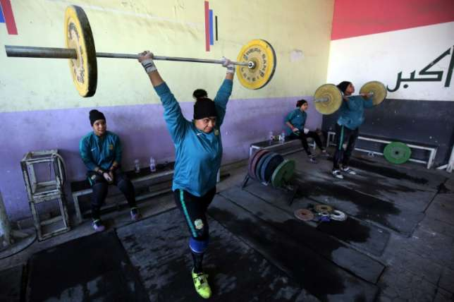 FEMALE WEIGHT-LIFTERS IN IRAQ TRAIN HARD TO ALSO BOOST FAMILY FINANCES
